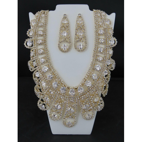 373 - Costume Jewellery. A necklace and earring set, encrusted with white stones....