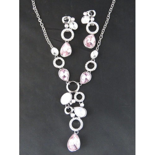 375 - Costume Jewellery. Necklace and earring set. Pink and opalescent teardrop stones (£51.99 on labels)...