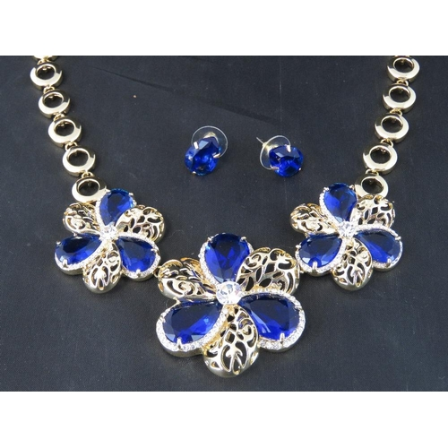 376 - Costume Jewellery. Necklace and earring set. Blue flower design with blue teardrop shape earrings (£...