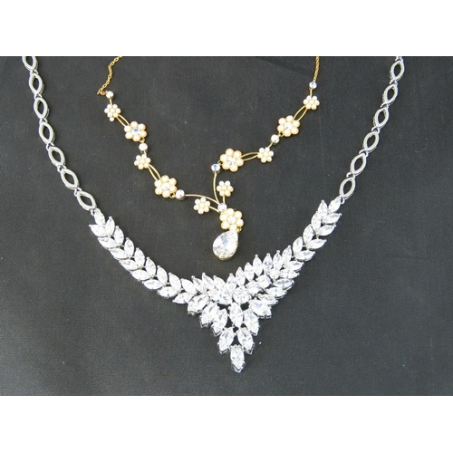 377 - Costume Jewellery. Two necklaces, one with white stones and one with faux seed pearl flower pattern ...