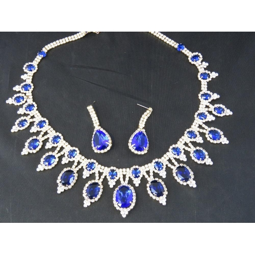 379 - Costume Jewellery. Necklace and earring set. Blue and white stones....