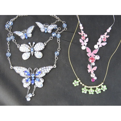 380 - Costume Jewellery. Necklace and earring set - Blue butterflies (slightly a/f). Also a pink butterfly...