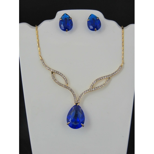 381 - Costume Jewellery. Necklace and earring set. Blue teardrop design (£41.99 on labels)....