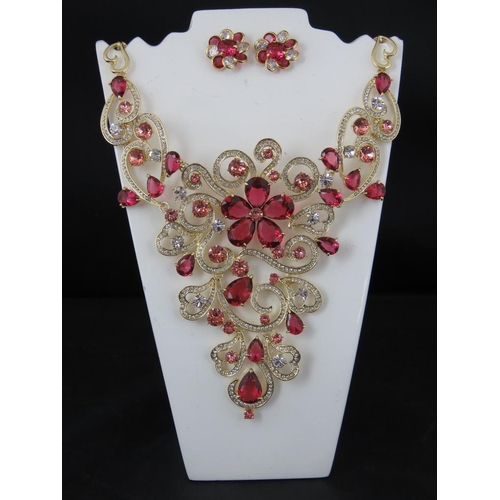 382 - Costume Jewellery. A necklace and earring set, pink flower design with white stone hearts and heart ...