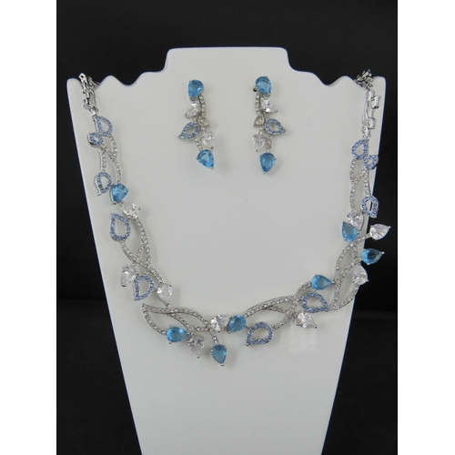 385 - Costume Jewellery. Necklace and earring set. Blue and white teardrop stones (£51.99 on labels)....