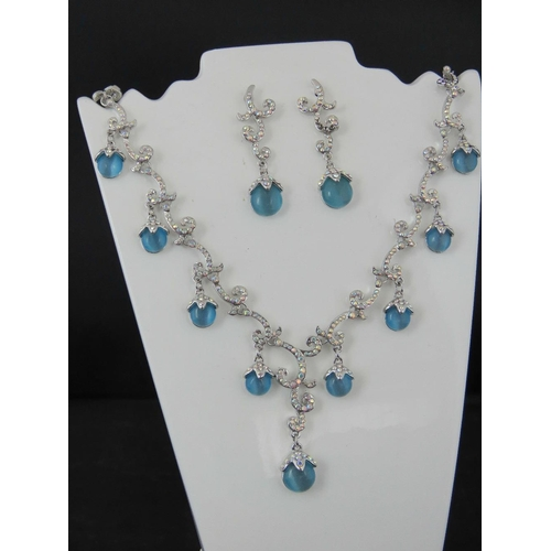 386 - Costume Jewellery. Necklace and earring set. Encrusted with multi colour and blue opalescent stones ...