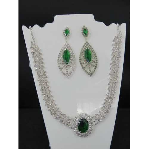 387 - Costume Jewellery. Necklace and earring set. Green and white stones (£45.99 on labels)....