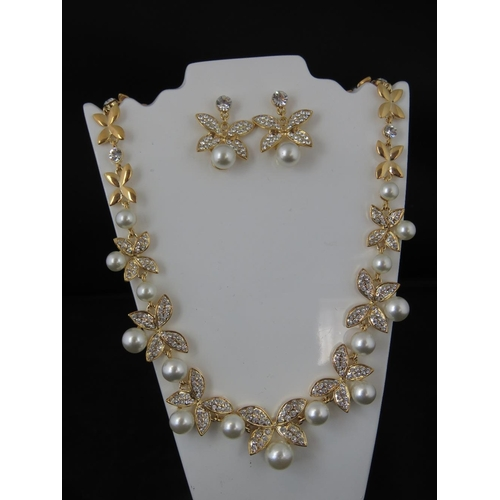 388 - Costume Jewellery. Necklace and earring set. Faux pearl and white stone butterfly design (£39.99 on ...