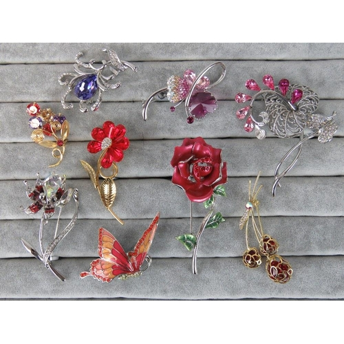 389 - Costume Jewellery. Nine brooches of various styles and colours (£112.98 on labels, two brooches with...