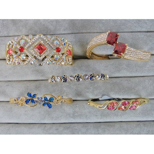396 - Costume Jewellery. Five bangles of various styles and colours (£139.95 on labels)....