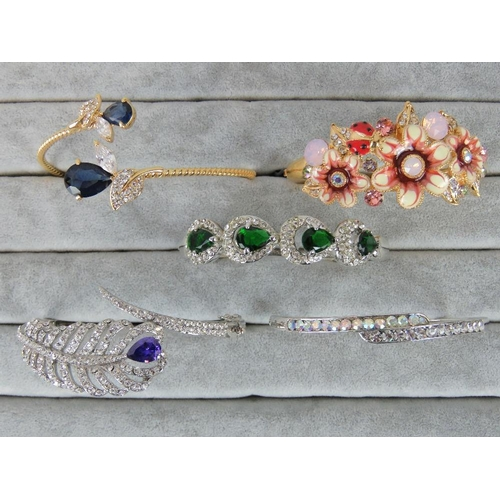 397 - Costume Jewellery. Five bangles of various styles and colours (£119.95 on labels, one bracelet witho...