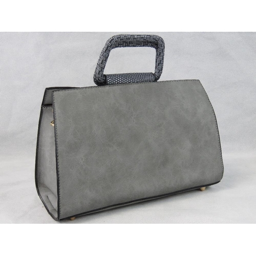 42 - Handbag. Grey, two handles, zip closure, two internal zip pockets and two internal open pockets, zip...