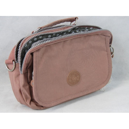 44 - Handbag. Dusky pink, single handle, two zip closing compartments, internal zip pocket, zip pocket wi...