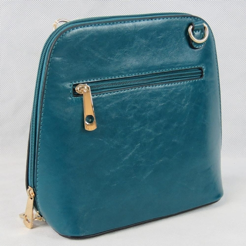 49 - Handbag. Sea green, shoulder strap, zip closure, two internal zip pockets. 22cm wide....
