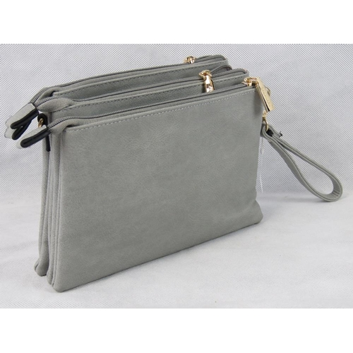 50 - Clutch bag. Grey, three zip closure compartments, one internal zip pocket and two internal open pock...