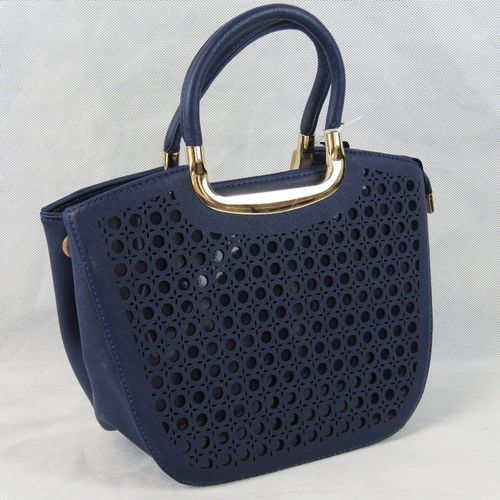 51 - Handbag. Navy with pierced detail to front, two handles, zip closure, three internal zip pockets and...
