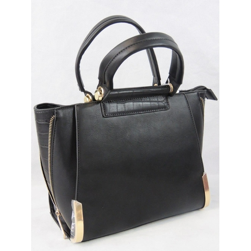 54 - Handbag. Black with zip detail to sides, two handles, zip closure, two internal zip pockets and two ...