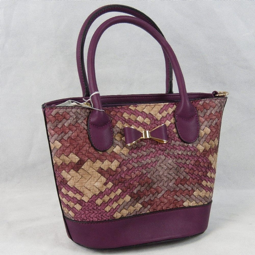 57 - Handbag. Purple woven design, bow detail, two handles, zip closure, internal zip pocket and two inte...