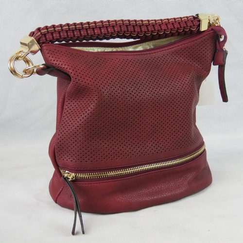 6 - Handbag. Red with piercing and zip detail, single braided handle, zip closure, two internal zip pock...