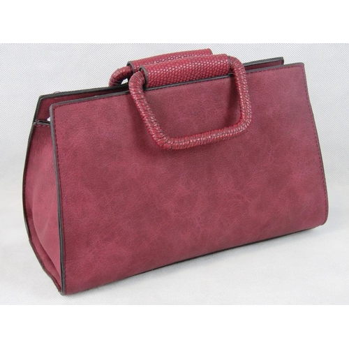 66 - Handbag. Burgundy, two handles, zip closure, two internal zip pockets and two internal open pockets,...