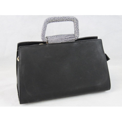 68 - Handbag. Black, two handles, zip closure, two internal zip pockets and two internal open pockets, zi...