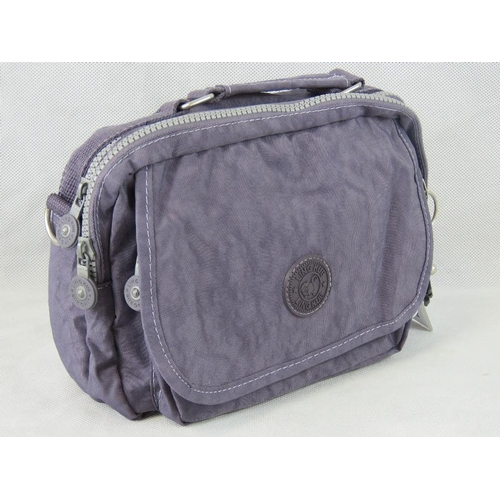 76 - Handbag. Lilac, single handle, two zip closing compartments, internal zip pocket, zip pocket with ve...