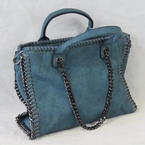 81 - Handbag. Blue with black chain details, two handles, zip closure, two internal zip pockets and two i...