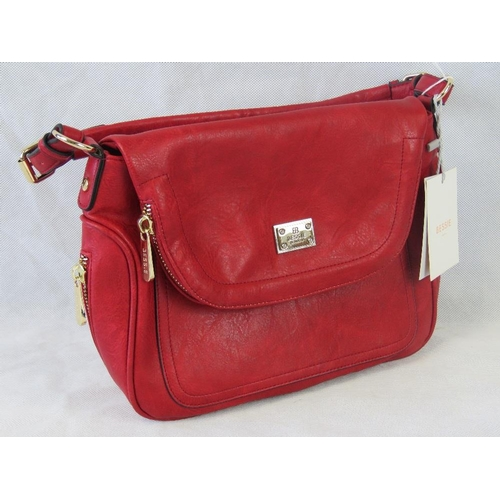 87 - Handbag. Red with zip detailing, one handle, popper closure, internal zip pocket and two internal op...
