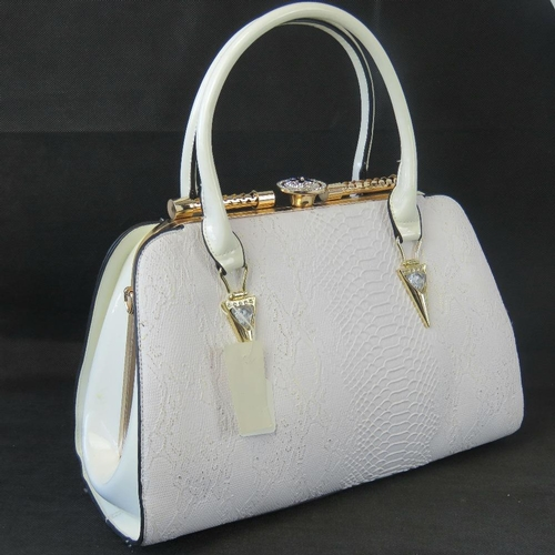 88 - Handbag. White python effect, two handles, clasp closure, two internal zip pockets and two internal ...