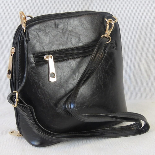 89 - Handbag. Black, shoulder strap, zip closure, two internal zip pockets. 22cm wide....