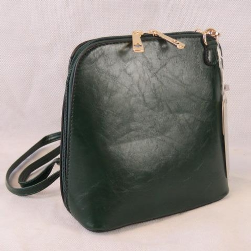 91 - Handbag. Dark green, shoulder strap, zip closure, two internal zip pockets. 22cm wide....