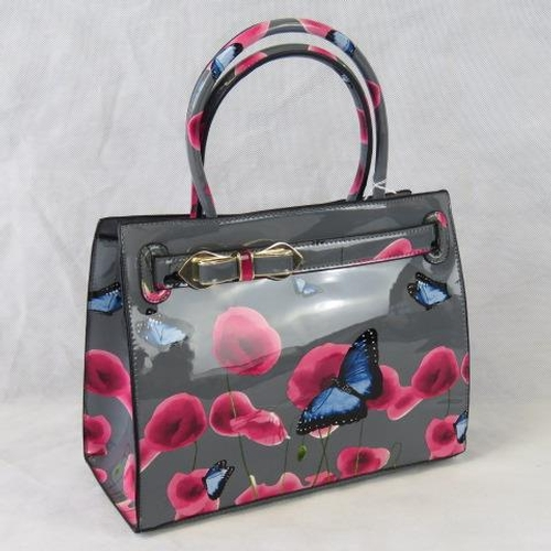 96 - Handbag, Grey ground with pink/poppy and blue butterfly design, bow detail, two handles, zip closure...
