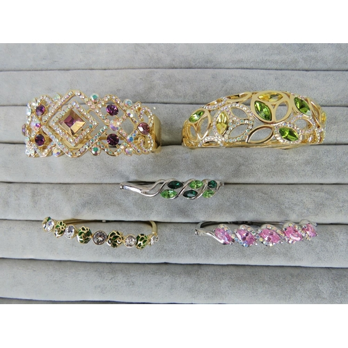 402 - Costume Jewellery. Five bangles of various styles and colours (£159.95 on labels)....