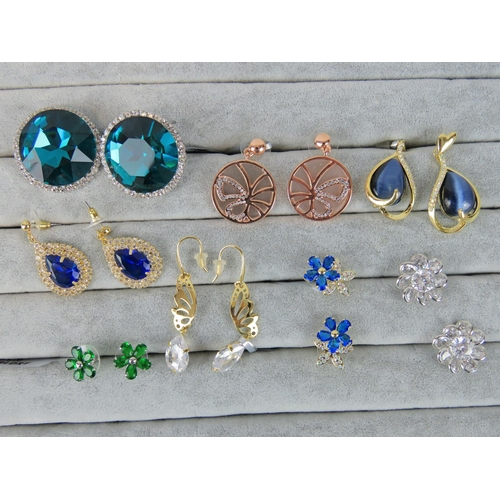 410 - Costume Jewellery. Eight pairs of earrings, variety of styles and colours (£83 on labels, one pair w...