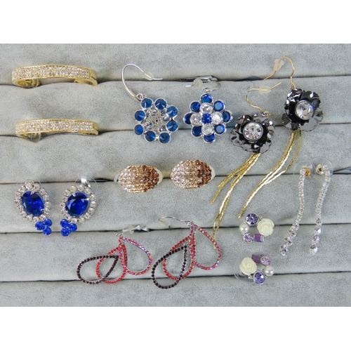 412 - Costume Jewellery. Eight pairs of earrings, variety of styles and colours (£70 on labels, one pair w...