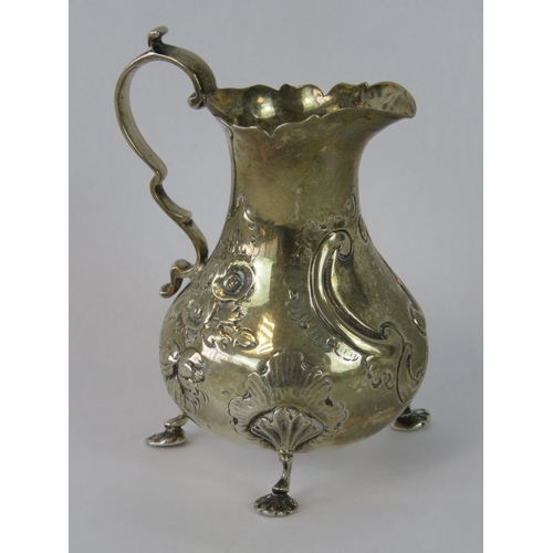 1 - A HM silver Victorian cream jug with three cast feet, London 1874, 3.19ozt...