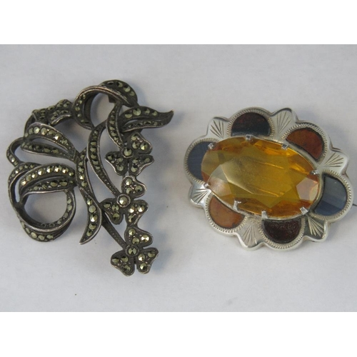 102 - Two silver brooches; one set with Scottish agate and large central oval citrine hallmarked Edinburgh...