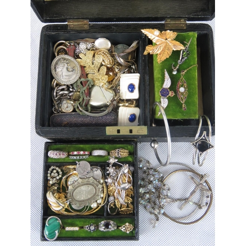 126 - A vintage black leather jewellery box containing costume and silver jewellery....