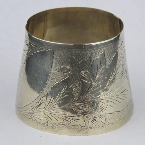 132 - A pale yellow metal conical cuff bangle, stamped 9ct, engraved with floral pattern, 45.35g, 4.5cm wi...
