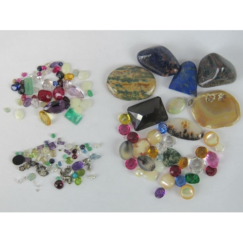 134 - A quantity of loose semi precious and paste stones including rubies, sapphires etc....