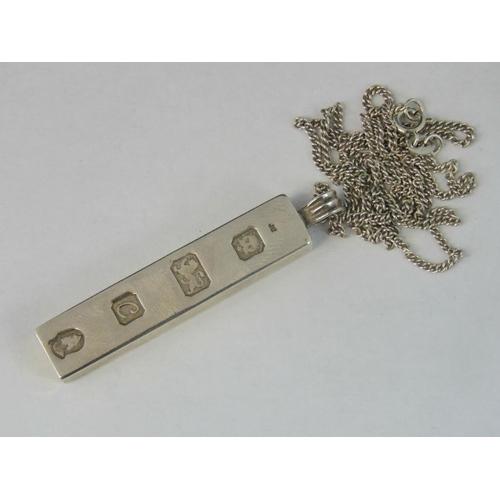 145 - A silver ingot on silver chain, Hallmarked London 1977, 30.33g....