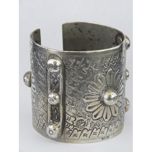 167 - A heavy white metal cuff bangle with Arabic hallmarks....