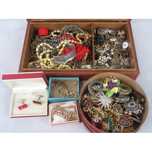 183 - A vintage leather jewellery box containing a quantity of costume jewellery and a circular box of bro...