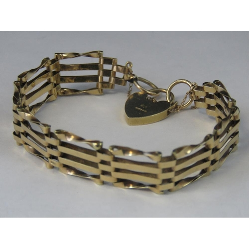 184 - A 9ct gold four bar gate bracelet with hallmarked heart clasp, 10.48g...
