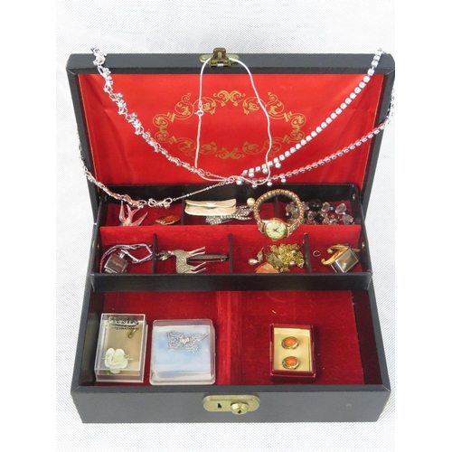 193 - A quantity of costume jewellery including brooches necklaces, a 9ct front and back locket etc. Withi...