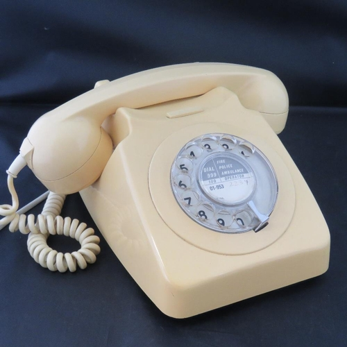 675 - A General Post Office plastic rotary dial telephone No 746 in cream, C1970's....