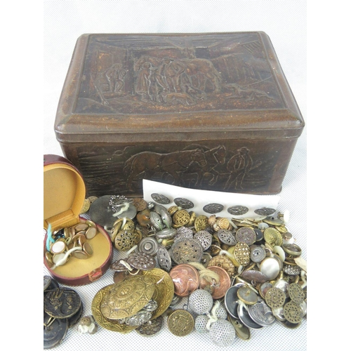 681 - A metal box containing a quantity of buttons, a cut steel buckle, and a leather studs box....
