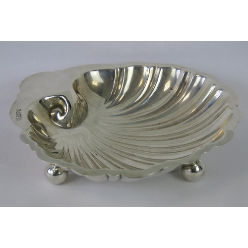 7 - A HM silver sugar bowl of shell form on three ball feet, Chester 1920, maker Barker Bros, 2.73ozt...