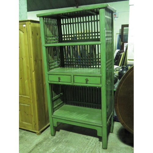 1109 - An oriental green-painted hardwood open-front shelf unit with twin drawers. 102cm wide, 192cm high....