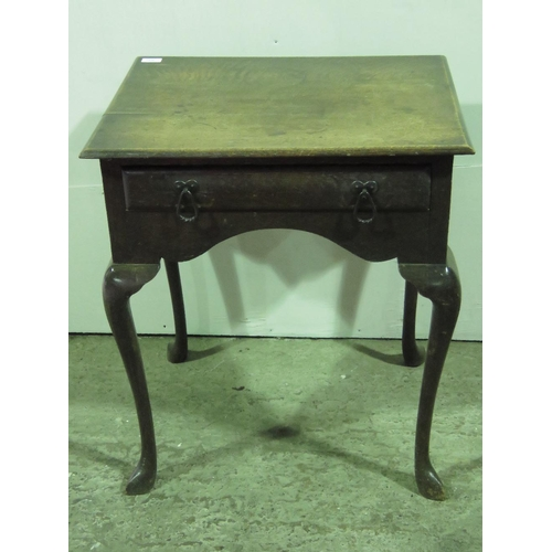 1110 - A 19th century country made oak low boy with single drawer and cabriole legs; 61cm wide....